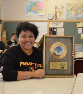 SWW student with go-go gold record