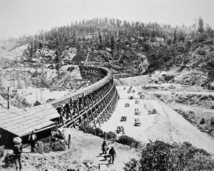 Chinese labourers working on a trestle bridge on the western slope of the Sierra Nevada mountains.