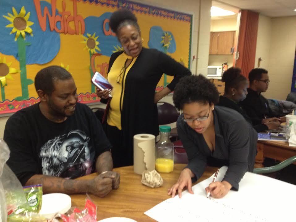 Isaiah Lyles, at left, participates in a meeting coordinated by Orr's parent center.