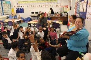 Roving Readers at Brightwood - kids raising hands 2