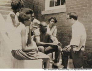 Mark Levy (far right), Queens College Class of 1964, talking with Mississippi high school students Lelia Jean Waterhouse, Roscoe Jones and Caroline Tartt (front row, left to right) outside the Meridian Freedom School in the summer of 1964.