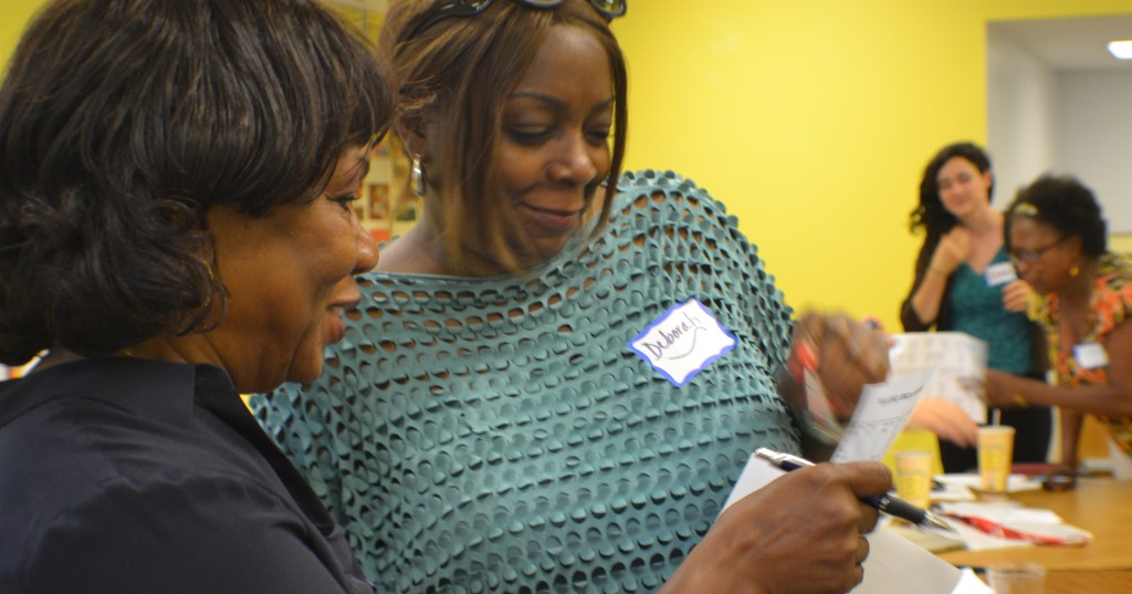 Thomson ES grandparent Betty Wilson (left) and LaSalle-Backus EC principal Dr. Laverne Cox exchange stories during the ice breaker.