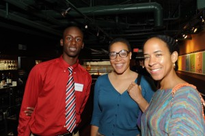 Ellis (rights) greets guests at reception for McComb Youth at Eatonville in June 2012.