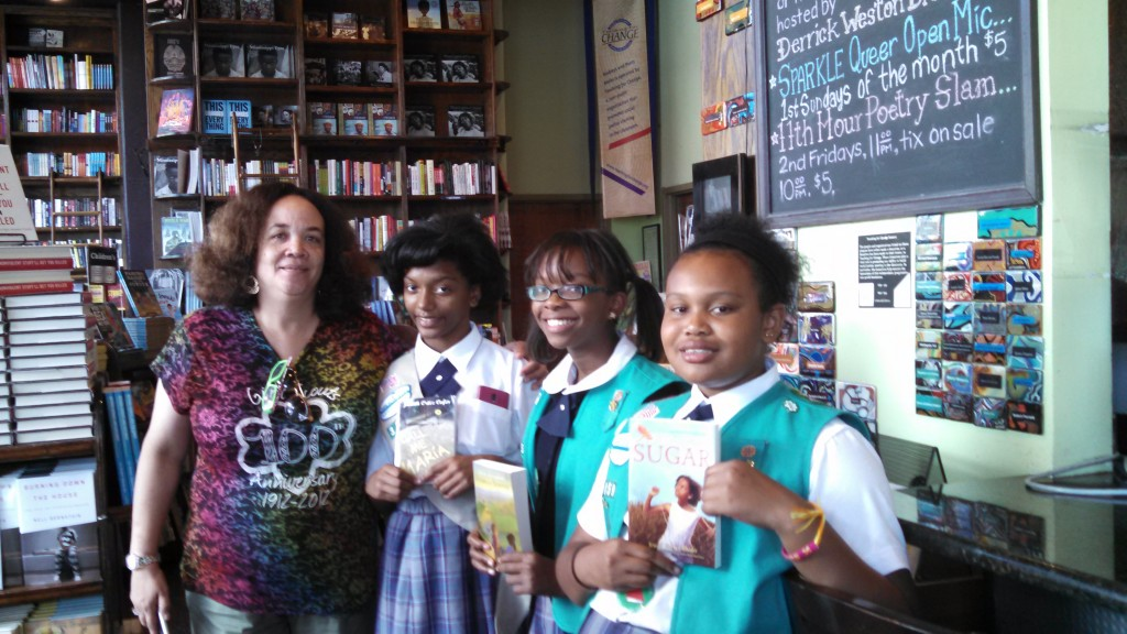 Troop leader Dena Grant and three of the many girls scouts involved with the book drive.