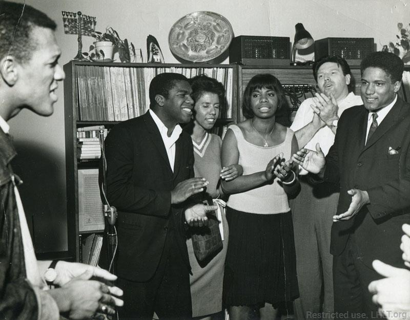 1963 SNCC fundraiser at the home of actor and activist Theodore Bikel. (l-r) Ivanhoe Donaldson, Chuck McDew, Lorraine Hansberry, Nina Simone, Theodore Bikel, and James Forman. (c) Lorraine Hansberry Literary Trust (LHLT) private collection. Click for more info.
