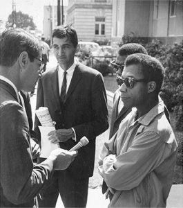 Howard Zinn and James Baldwin speak with the media on Freedom Day in October, 1963.