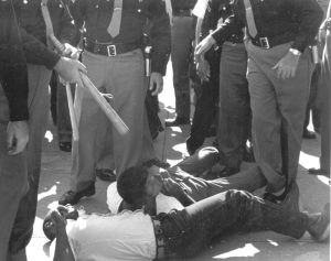 SNCC volunteers beaten for attempting to  bring water and sandwiches to people (many elderly) waiting in hot sun for hours to register to vote. Photo by John Kouns.