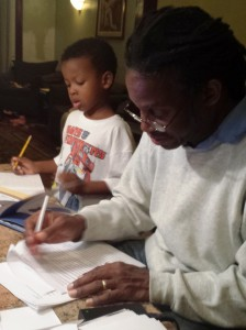 The Lusanes doing homework together.
