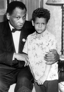 Paul Leroy Robeson, actor, athlete, scholar, singer and lawyer, passes on words of wisdom to Julian Bond, future civil rights activist and son of Lincoln University Horace Mann Bond. (John W. Mosley. 1949)
