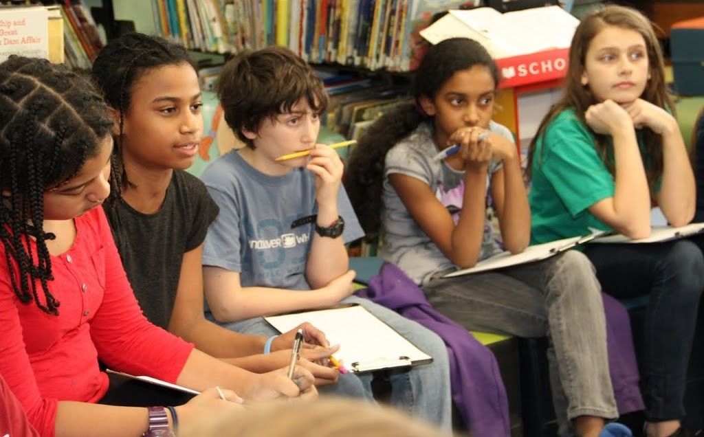 Sixth grade students at Bank Street analyzed book covers.
