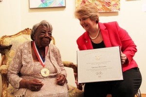 Wendy Spencer, CEO of the Corporation for National and Community Service, presents Ms. Virginia McLaurin, a Senior Corps volunteer, with the President's Volunteer Service Award for Lifetime Achievement in advance of her 107th birthday on March 12, 2016. (PRNewsFoto/Corporation for National and Co)