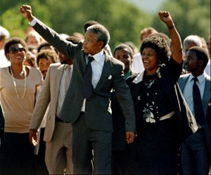 African National Congress (ANC) leader Nelson Mandela and wife Winnie raise fists upon his release from Victor Verster prison, 11 February 1990 in Paarl. After the banning of the ANC in 1960, Nelson Mandela argued for the setting up of a military wing within the ANC. On June 12, 1964, eight of the accused, including Mandela, were sentenced to life imprisonment. Nelson Mandela was released 11 February 1990. AFP PHOTO ALEXANDER JOE