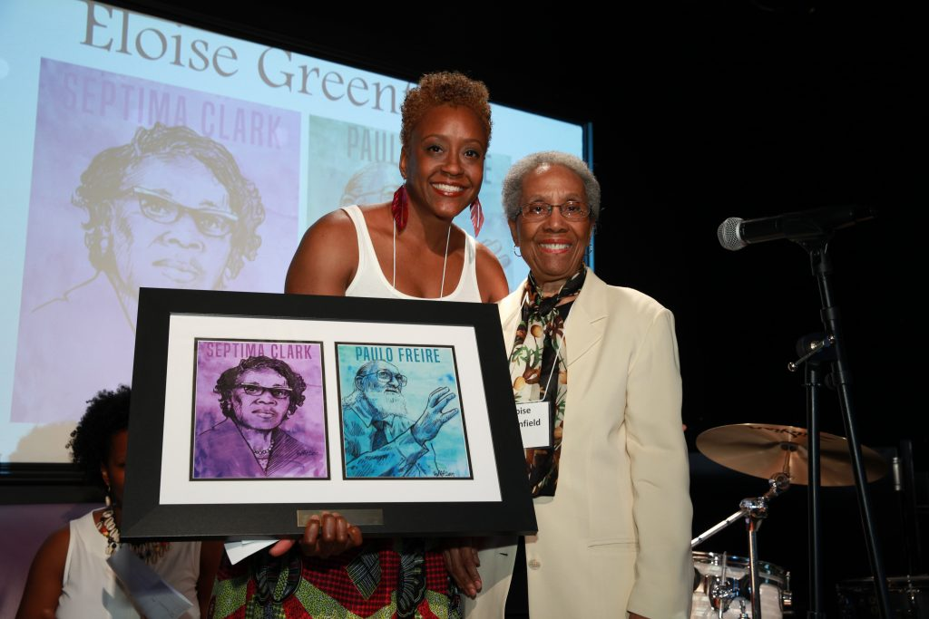 Nzinga Tull presents the Education for Liberation Award to Eloise Greenfield.© Rick Reinhard 2016